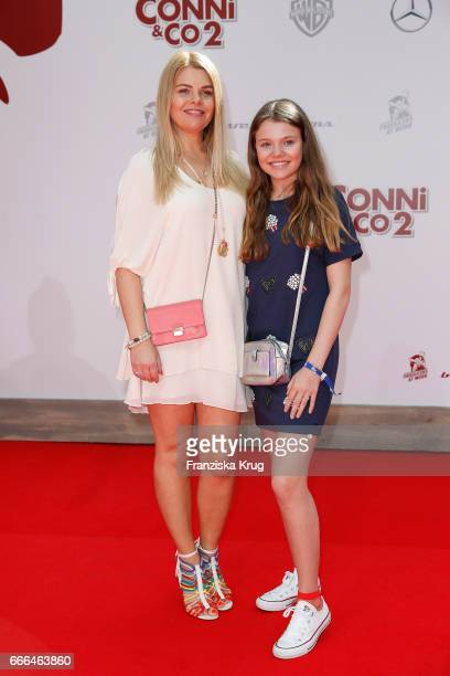 AnneSophie Briest and her daughter Faye Montana attend the 'Conni Co 2 Das Geheimnis des TRex' premiere on April 9 2017 in Berlin Germany