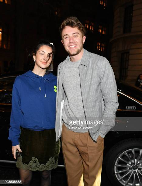AnneSophie Flury and Roman Kemp arrive in an Audi at the GQ Car Awards at Corinthia London on February 03 2020 in London England