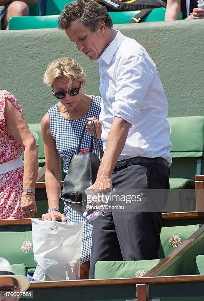 AnneSophie Lapix and Arthur Sadoun attend the French Open at Roland Garros on June 5 2015 in Paris France