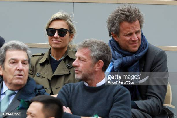 AnneSophie Lapix and her husband Arthur Sadoun attend the 2019 French Tennis Open Day Thirteen at Roland Garros on June 07 2019 in Paris France