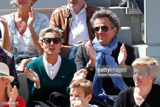 AnneSophie Lapix and her husband Arthur Sadoun attend the 2019 French Tennis Open Day Fourteen at Roland Garros on June 08 2019 in Paris France