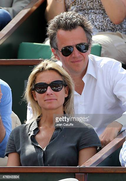 AnneSophie Lapix and her husband Arthur Sadoun attend the men's final on day 15 of the French Open 2015 at Roland Garros stadium on June 56 2015 in...