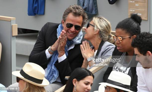 AnneSophie Lapix and husband Arthur Sadoun attend the men's final during day 15 of the 2019 French Open at Roland Garros stadium on June 9 2019 in...