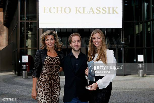AnneSophie Mutter Felix Klieser and Nina Eichinger attend the ECHO Klassik 2014 photo call at Philharmonie on October 24 2014 in Munich Germany