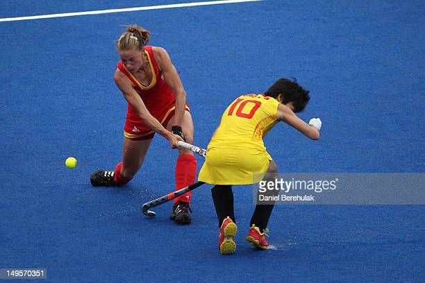 AnneSophie Van Regemortel of Belgium strikes Lihua Gao of China with her stick during the Women's Hockey Match between Belgium and China on day 4 of...