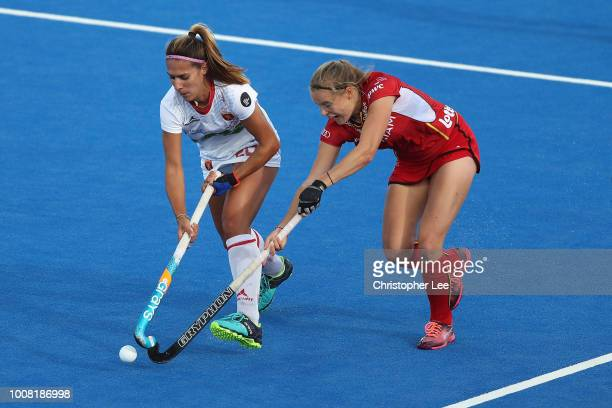AnneSophie Weyns of Belgium battles with Xantal Gine of Spain during the Crossover game between Belgium and Spain of the FIH Womens Hockey World Cup...