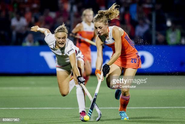 AnneSophie Weyns of Belgium duels with Laura Nunnink of The Netherlands during the Women's final match Netherlands v Belgium at The Rabo EuroHockey...
