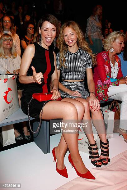 Annett Moeller and Birte Glang attend the Anja Gockel show during the MercedesBenz Fashion Week Berlin Spring/Summer 2016 at Brandenburg Gate on July...