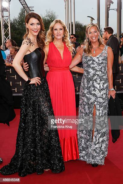 Annett Moeller Katja Burkard and Birgit von Bentzel attend the red carpet of the Deutscher Fernsehpreis 2014 on October 02 2014 in Cologne Germany