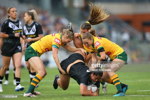 Annetta Nuuausala of New Zealand is tackled during the International Rugby League match between the Australian Jillaroos and the New Zealand Kiwi...