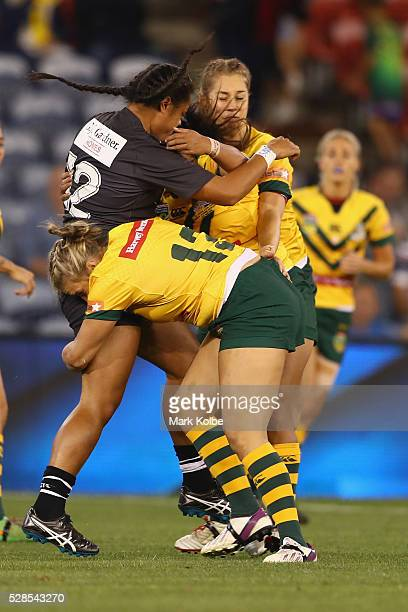 Annetta Nuuausala of the Kiwi Ferns is tackled by Ruan Sims of the Jillaroos during the Women's international Rugby League Test match between the...