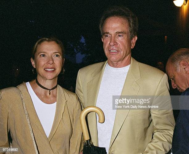 """Annette Bening and husband Warren Beatty arrive for the opening night of Chekhov's """"The Seagull"""" at the Delacorte Theater in Central Park. Rain..."""