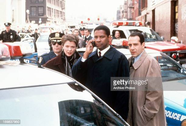 Annette Bening Denzel Washington and Tony Shalhoub at a disastrous situation in a scene from the film 'The Siege' 1998
