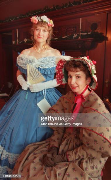 Annette Boet models an 1860 ballgown and Kathy Tschida wears a pelerine day dress for an histroric fashion show of Victorian and Edwardian dresses.