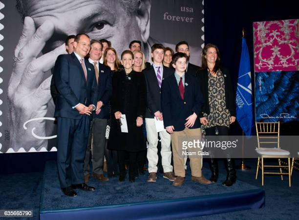 Annette de la Renta poses for a photo with family members at the Oscar de la Renta Forever Stamp dedication ceremony at Grand Central Terminal on...