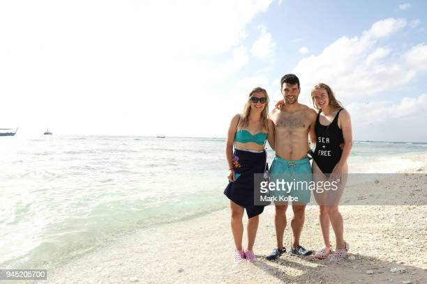 Annette Edmondson Nathan Hart and Alexandra Manly of Australia pose ont he beach during an athlete Great Barrier Reef experience on day eight of the...
