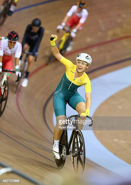 Annette Edmondson of Australia celebrates after winning Gold in the Women's 10km Scratch Race at Sir Chris Hoy Velodrome during day three of the...