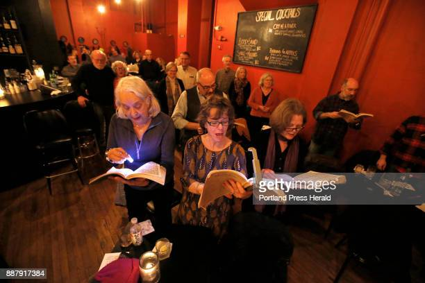 Annette Elowitch front left Kathleen Egan and Andrea Rosenberg sing along with other audience members during the third annual Barroom Messiah on...