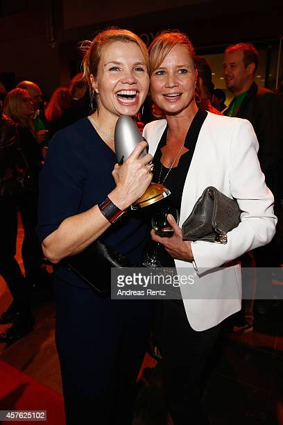 Annette Frier and her sister Sabine Frier attend the 18th Annual German Comedy Awards at Coloneum on October 21 2014 in Cologne Germany The show will...