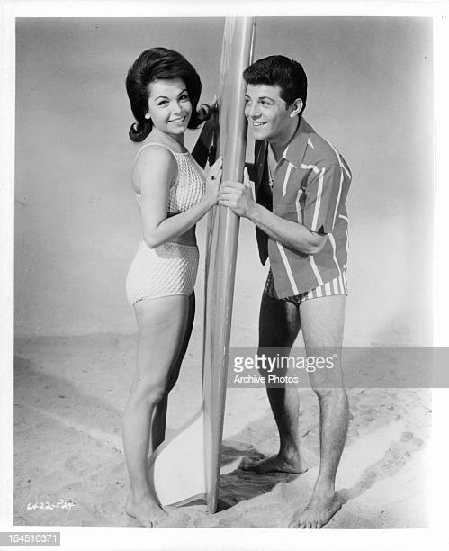 Annette Funicello and Frankie Avalon with surfboard in publicity portrait for the film 'Bikini Beach' 1964