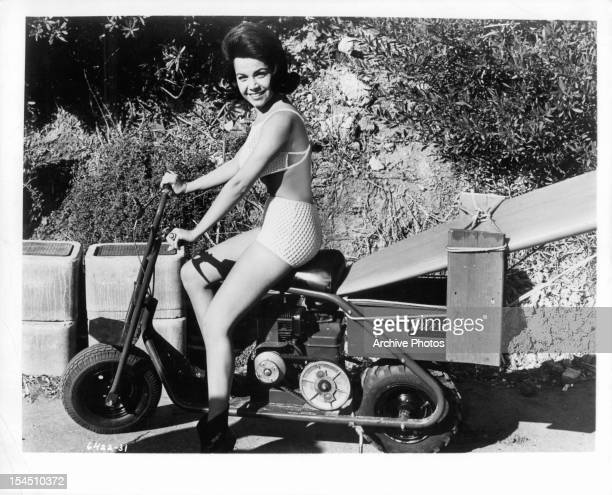 Annette Funicello sits on motor scooter in publicity portrait for the film 'Bikini Beach' 1964