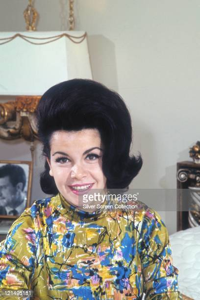 Annette Funicello US actress and singer smiling with a black bouffant hairstyle and wearing a print pattern polo neck top circa 1960
