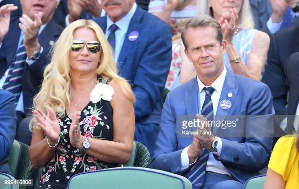 Annette Hjort Olsen and Stefan Edberg attend the men's singles final on day thirteen of the Wimbledon Tennis Championships at the All England Lawn...