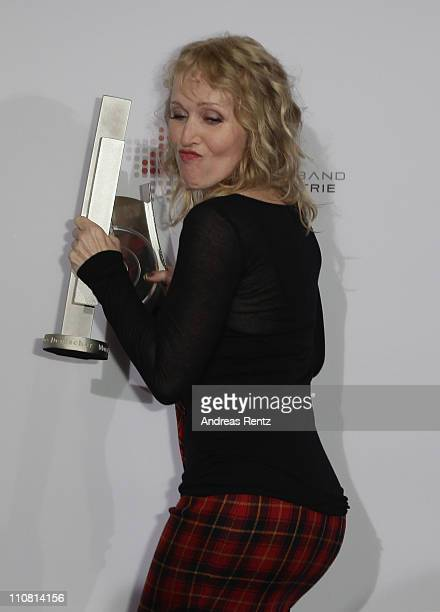 Annette Humpe poses with her award during the Echo award 2011 at Palais am Funkturm on March 24 2011 in Berlin Germany