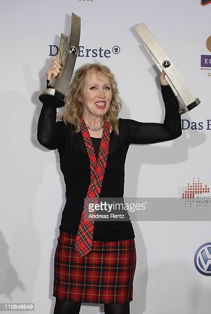 Annette Humpe poses with her awards during the Echo award 2011 at Palais am Funkturm on March 24 2011 in Berlin Germany