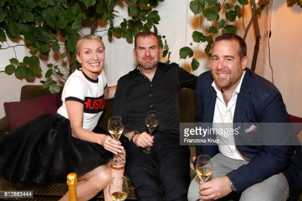 Annette Jensen her husband Ulrik Lackschewitz and Joerg Bernicken attend the 'Krug Kiosk' Event on July 11 2017 in Hamburg Germany