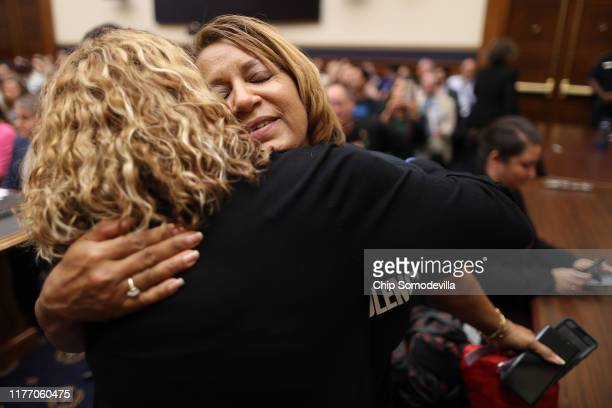 Annette NanceHolt embraces US House Judiciary Committee member Rep Lucy McBath before a hearing on assault weapons in the Rayburn House Office...