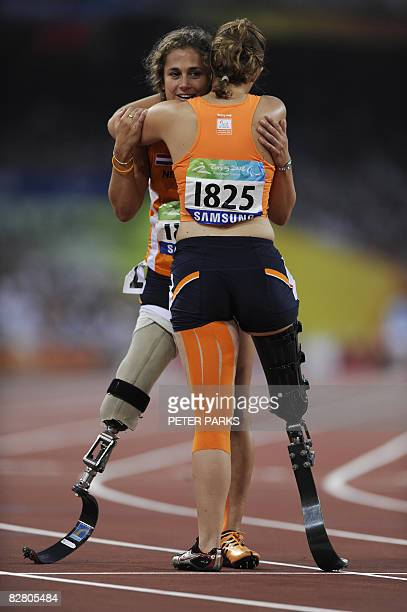 Annette Roozen and Marije Smits of the Netherlands celebrate after the women's 100m T42 final during the 2008 Beijing Paralympic Games at the...