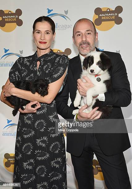 Annette Roque and television journalist Matt Lauer pose for a picture with a dog at the 2013 Animal League America Celebrity gala at The Waldorf...