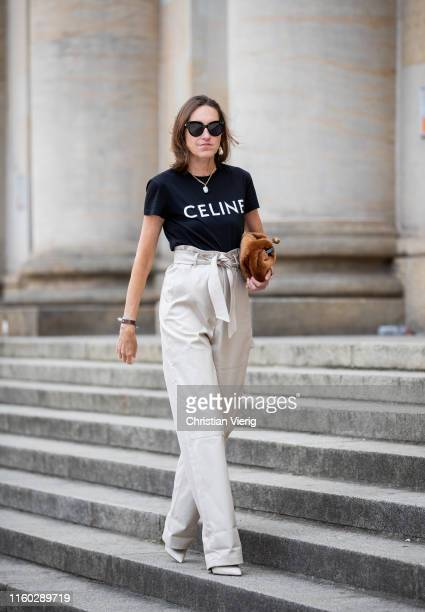 Annette Weber is seen wearing cargo pants Max Mara faux fur bag Max Mara tshirt with logo print Celine Max Mara shoes during Berlin Fashion Week on...