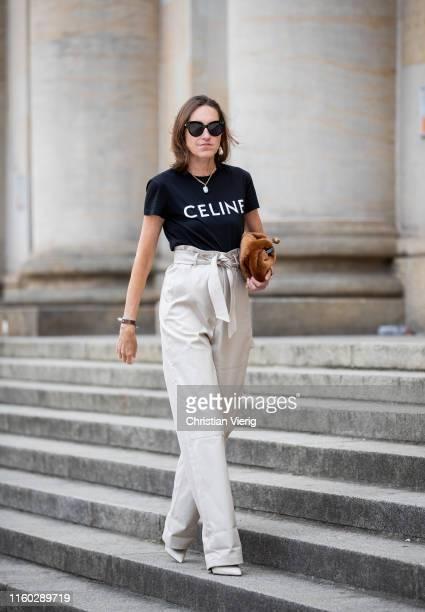 Annette Weber is seen wearing cargo pants Max Mara, faux fur bag Max Mara, tshirt with logo print Celine, Max Mara shoes during Berlin Fashion Week...
