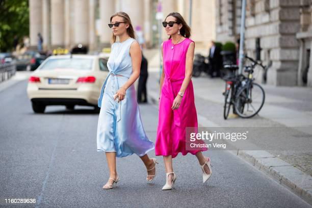 Annette Weber is seen wearing pink Milk White dress and Alexandra Seifert wearing blue Milk White Dress seen during Berlin Fashion Week on July 04...