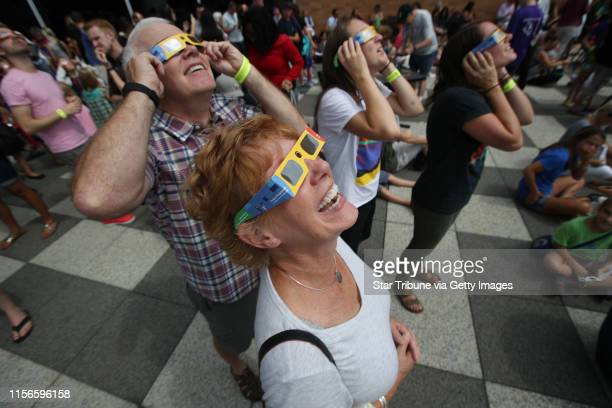 Annette Whaley left with her husband John Whaley Carolyn Wharton and her wife Lauren Whaley watched a partial eclipse at the Science Museum of...