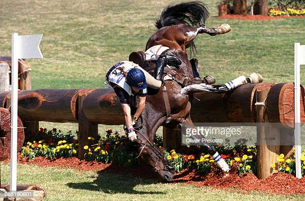 Annette Wyrwoll from Germany come off her horse Bantry Bay during the cross country leg of the threeday event competition at the 2000 Sydney Olympics