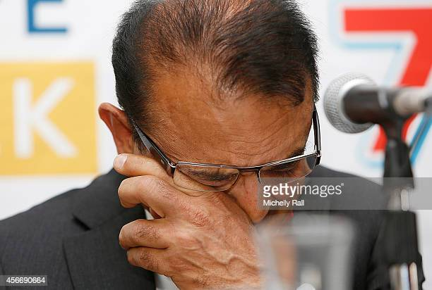 Anni Dewani's father Mr Vinod Hindocha breaks down in tears during a press conference on the eve of the Shrien Dewani trial on October 5 2014 in Cape...