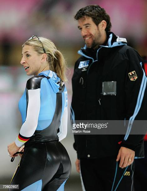 Anni Friesinger of Germany and her coach Gianni Romme of Netherlands look on after the women's 1000 meters during Day 3 of the Essent ISU Speed...