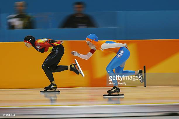 Anni Friesinger of Germany and Tonny de Jong of the Netherlands compete in the women's 5000m speed skating event during the Salt Lake City Winter...