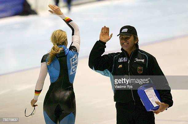 Anni Friesinger of Germany celebrates with coach Markus Eicher after winning the women's 500m sprint final during the World Allround speed skating...