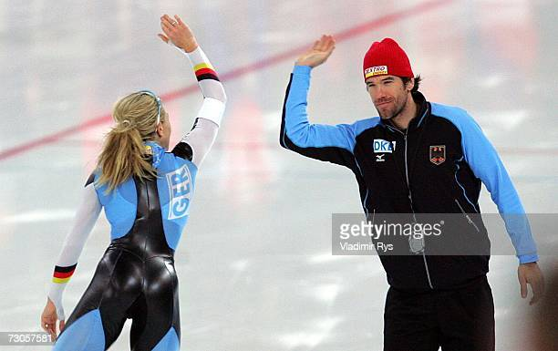 Anni Friesinger of Germany celebrates with her coach Gianni Romme after competing at the 500m womens heat during the World Sprint Speed Skating...