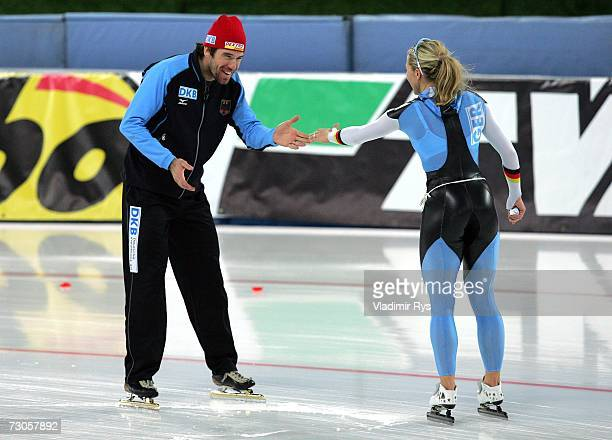 Anni Friesinger of Germany celebrates with her coach Gianni Romme after winning the World Championship in 1000m womens sprint during the World Sprint...