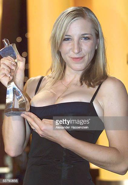 Anni Friesinger shows her trophy after taking the second place during the sports gala athlete of the year 2001 on December 22 2001 in BadenBaden...