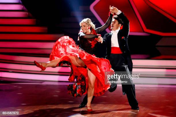 Anni FriesingerPostma and Erich Klann perform on stage during the 1st show of the tenth season of the television competition 'Let's Dance' on March...