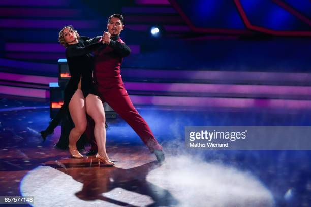 Anni FriesingerPostma and Erich Klann perform on stage during the 2nd show of the tenth season of the television competition 'Let's Dance' on March...