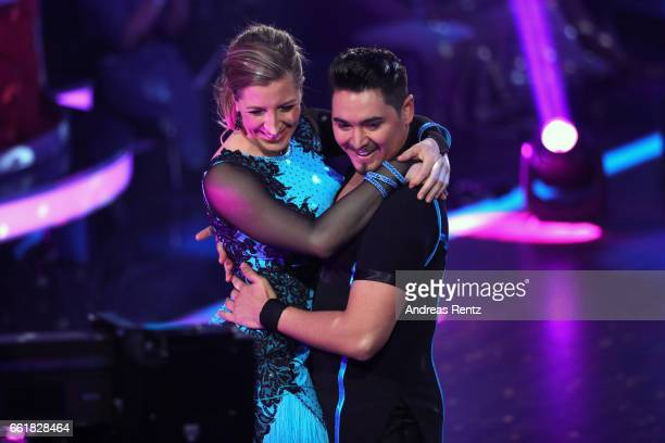 Anni FriesingerPostma and Erich Klann perform on stage during the 3rd show of the tenth season of the television competition 'Let's Dance' on March...