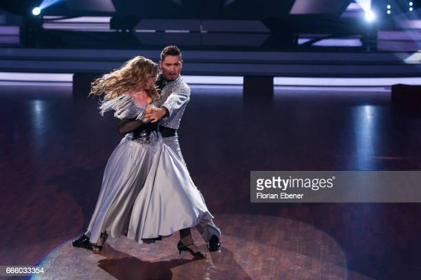 Anni FriesingerPostma and Erich Klann perform on stage during the 4th show of the tenth season of the television competition 'Let's Dance' on April 7...