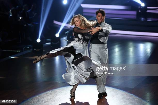 Anni FriesingerPostma and Erich Klann perform on stage during the final show of the tenth season of the television competition 'Let's Dance' on June...